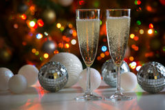 Two champagne glasses and christmas balls Royalty Free Stock Images