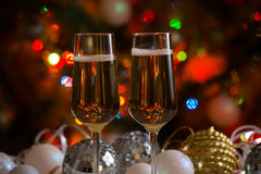 Two champagne glasses and christmas balls Royalty Free Stock Photos
