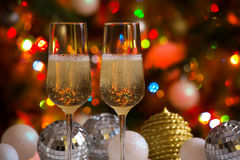 Two champagne glasses and christmas balls Stock Photography