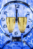Two Champagne glasses and clock Stock Photos