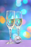 Two champagne glasses on colorful background with disco ball Stock Image