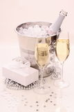 Two champagne glasses, gift, ice, cooler Stock Photos