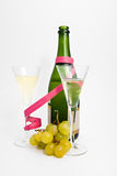 Two champagne glasses with grape. Two champagne glasses and bottle with grape  and providing Royalty Free Stock Photos