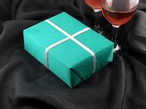 Two champagne glasses and green gift box Stock Photo