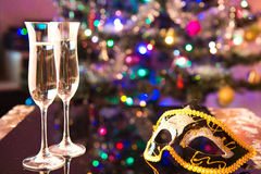 Two champagne glasses and a mask Royalty Free Stock Image