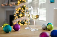 Two Champagne Glasses Near Baubles Royalty Free Stock Image