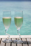 Two champagne glasses by the ocean Royalty Free Stock Photography