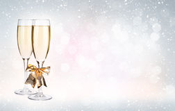 Two champagne glasses over christmas background Royalty Free Stock Images