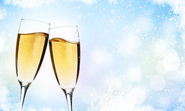 Two champagne glasses over christmas background Stock Photos