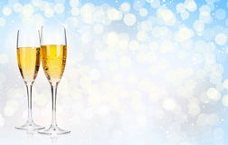 Two champagne glasses over christmas background Royalty Free Stock Image