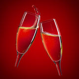 Two champagne glasses over red Stock Image