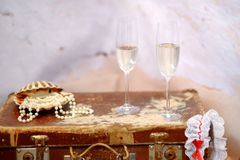 Two champagne glasses and pearls Stock Photo