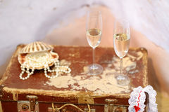 Two champagne glasses and pearls Stock Image
