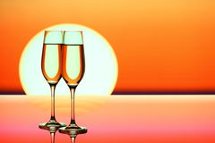 Two champagne glasses at sunset Royalty Free Stock Photo