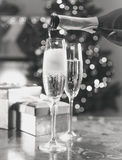 Two champagne glasses on table at living room decorated for Chri Royalty Free Stock Images