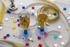 Two Champagne Glasses on a White Table royalty free stock photos