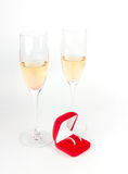 Two champagne goblets with jeweller box on white Royalty Free Stock Photos