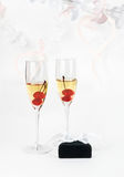 Two champagne goblets with jeweller box on white Royalty Free Stock Images