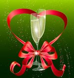 two champagne and red bow Royalty Free Stock Image