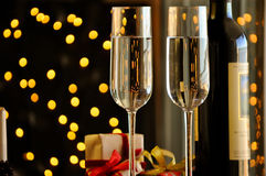 Two champagner glasses on glass table with black bokeh background Stock Images