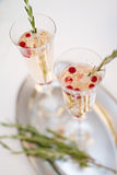 Two champaign glasses and strawberries isolated on white. Two champaign glasses and strawberries on a tray isolated on white background Royalty Free Stock Photo