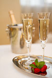 Two champaign glasses and strawberries isolated on white Royalty Free Stock Photography