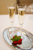Two champaign glasses and strawberries on white. Two champaign glasses and strawberries on tray on white background royalty free stock photo