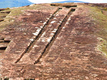Two channels on Samaipata Fortress. Two channels on the rock in archeological site El fuerte of Samaipata (Bolivia royalty free stock photos
