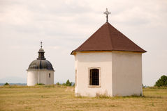 Two chapels on hill. Two adjacent catholic chapels on the hill Royalty Free Stock Photography
