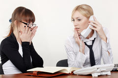 Two charming business woman. Talking in office Stock Photos