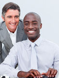 Two charming businessman working at a computer Royalty Free Stock Image