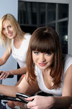 Two charming girls in a sports hall Stock Photo