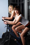 Two charming girls in a sports hall Stock Images