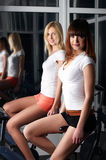 Two charming girls in a sports hall Royalty Free Stock Photography