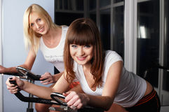 Two charming girls in a sports hall Stock Photos