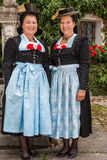 Two charming ladies in traditional dirndls Stock Images