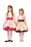 Two charming little girls in a dress Stock Image