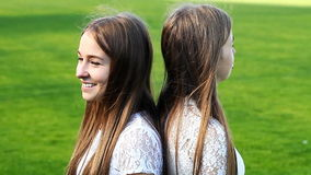 Two charming sisters emotional twins stock video