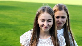 Two charming sisters emotional twins stock footage