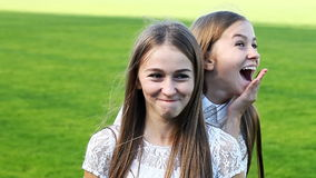 Two charming sisters emotional twins stock video footage