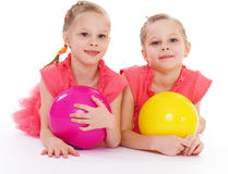 Two charming sisters love to play ball. stock photo