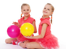 Two charming sisters love to play ball. Royalty Free Stock Image