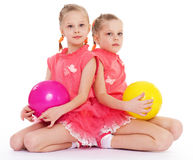 Two charming sisters love to play ball. Royalty Free Stock Photo