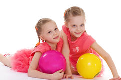 Two charming sisters love to play ball. Royalty Free Stock Photos