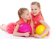 Two charming sisters love to play ball. Royalty Free Stock Photography