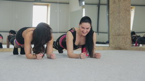 Two charming women are doing exercises in dance class. stock video footage