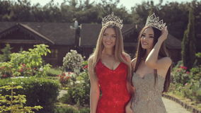 Two charming young girls in evening gowns and stock video footage