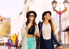 Two charming young women walking together smiling Royalty Free Stock Photo