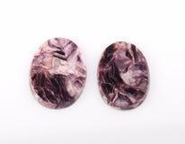 Two Charoite gemstone on white Stock Photo