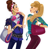 Two chattering fashion girls Stock Image